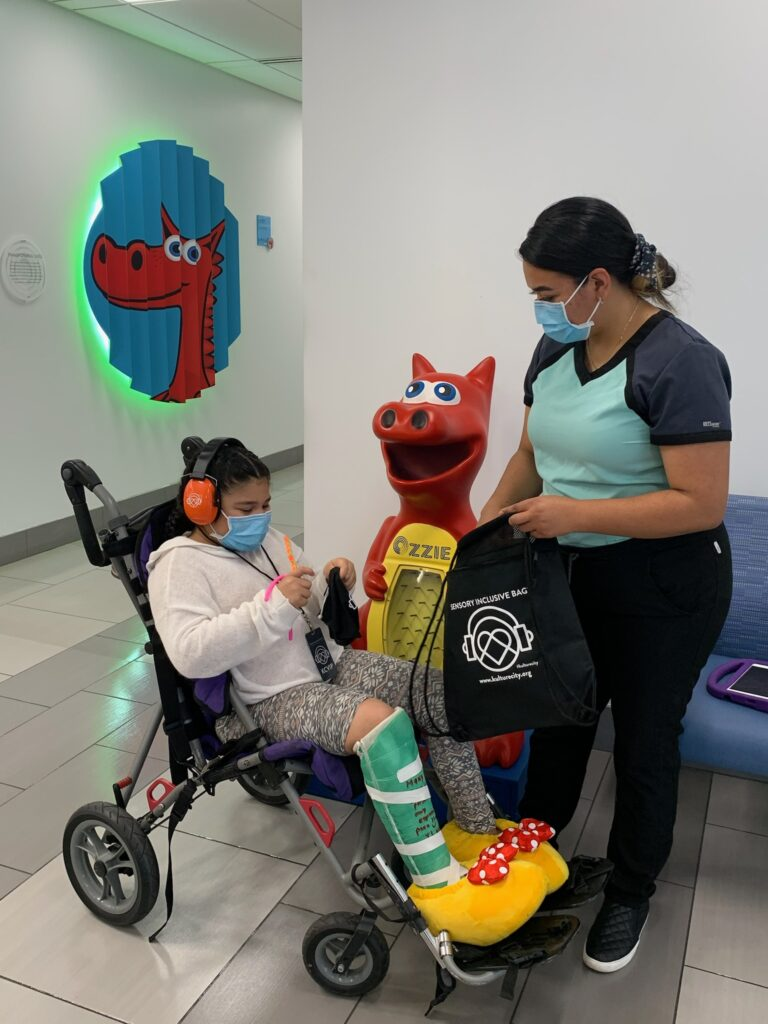 Child and mother happily in a sensory inclusive environment