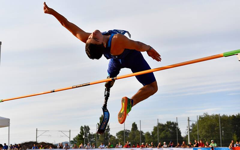 Ezra Frech mid jump crossing the High Jump bar at a recent competition